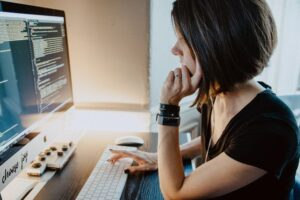 A web developer in front of her desktok ready for outsourcing web design.