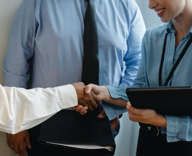 Corporate employees handshaking.
