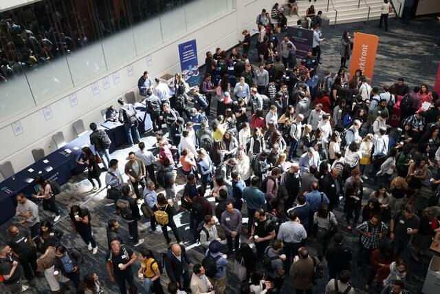 Many people visiting a trade event that growth hackers go to carry out growth hacking techniques for their business.